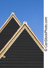 Roof shapes - Overlapping triangular roof shapes of restored...
