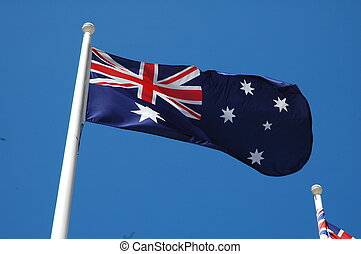 australian flag waving, blue sky without clouds, soffit