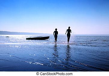 run 2 - silhouette image of two running girls in water