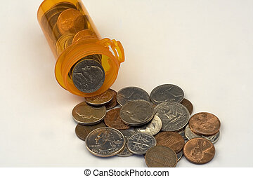 Pill bottle full of change - pill bottle overflowing with...