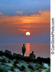 Sunset - Pair on seacoast on a sunset