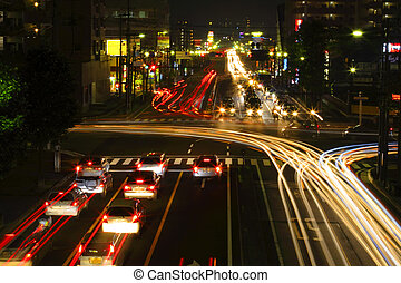 Night crossroad traffic - Traffic in a city crossroad during...