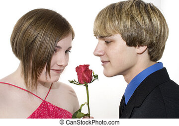 Adorable Teen Couple Looking at Rose - Adorable teen couple...