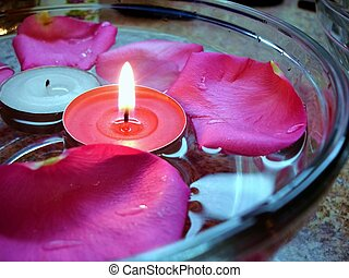 Spa Party - Glass bowl filled with water, floating pink rose...