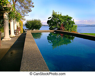 Reflections - Lap pool at the waterfront estate of a wealthy...