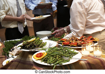 dinner being served at a wedding