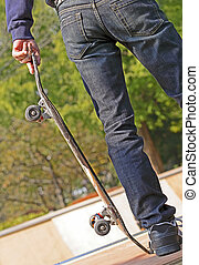 Skate boarder - Detail of a boy leg with a skateboard.