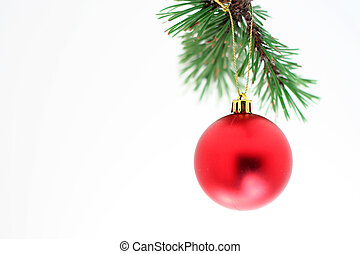Ornament - A red Chrstmas tree ornament shot against a white...