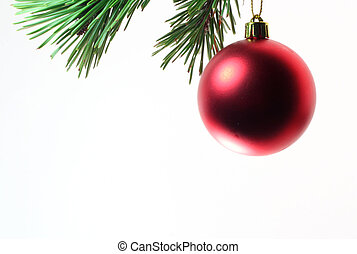 Hanging Around - A Christmas tree ornament hanging on a pine...