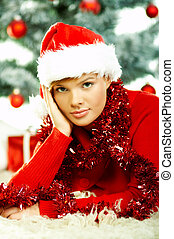 Beautiful Christmas 2 - Beautiful young woman wearing santas...