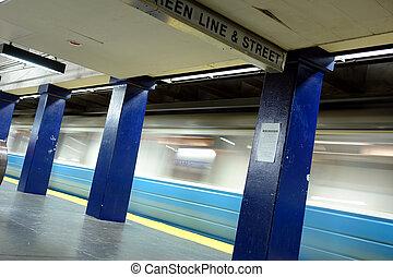 Blue line train in motion