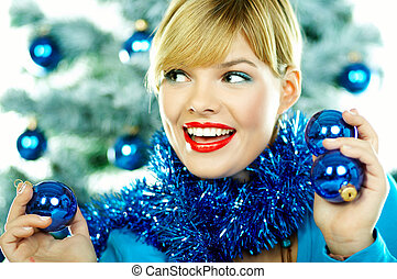 Beautiful Blue Christmas - Beautiful young woman next to...