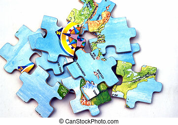Puzzle Pieces - Pieces of Puzzle lying against a white...