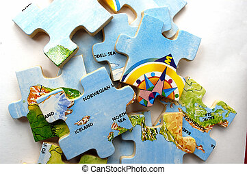 Pieces of a Puzzle - Pieces of a map puzzle against a white...