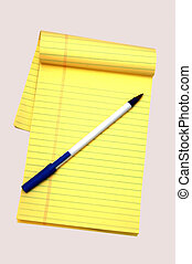 Yello notepad and a pen - Yellow notepad and a pen against a...