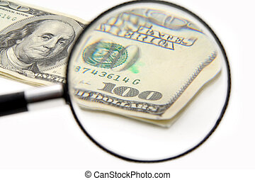 magnifying a 100 dollar, business concept