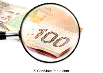 magnifying a 100 canadian dollar, business concept