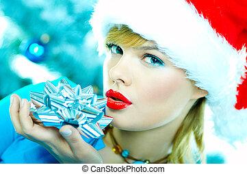 Beautiful Blue Christmas - Beautiful young woman wearing...