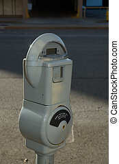 Parking Meter - parking meter next to the street with a...