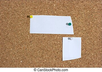 Messageboard - Two pieces of white paper on a pinboard. Add...