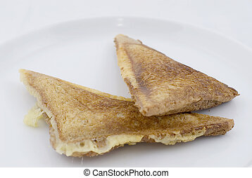 Toastie - A Cheese and Onion toasted sandwich on white plate