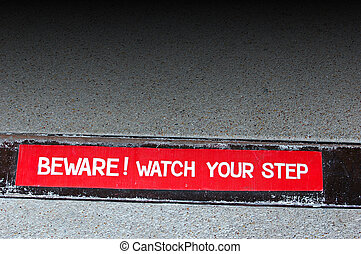 Watch your step - Hotel sign warning to watch your step