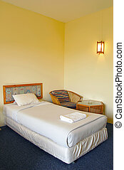 Bed - A single bed in a hotel room