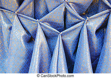 Pinned pleats - Blue and gold cloth with pinned pleats