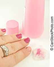 nail polish remover - woman holds cotton ball with nail...