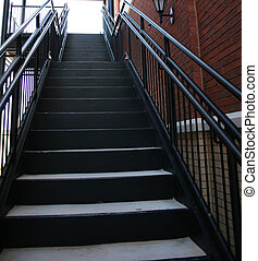 Iron Stairs - A view of a black iron staircase from ground...