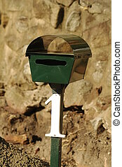 mailbox #1 - green mailbox with white number one on it,...