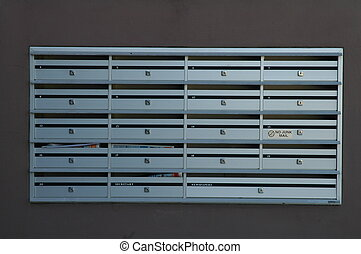 po boxes - 19 steel post boxes, grey wall in background, no...
