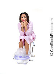 Foot bath - Woman having a foot bath on white background