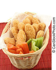 chicken fingers - basket of crispy chicken fingers with...