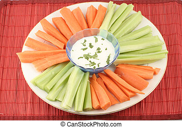 vegetable platter - celery and carrots on plate with bowl of...