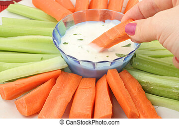 vegetable platter - fresh celery and carrots on plate with...