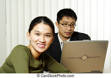 Business team - Businessman and businesswoman working...