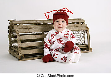 Lil Lobster - Baby dressed in lobster costume sitting next...