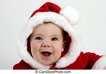 Santa Baby - Baby boy dressed in red Santa coat and hood...