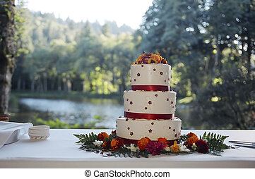 Wedding cake on table at outdoor reception