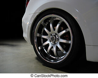 custom wheel detail - A closeup of a custom rim on a white...