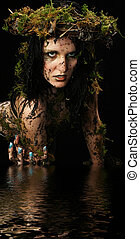 Swamp Princess - Young woman dresses as swamp creature in...