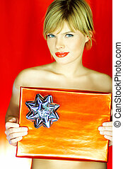 Sweet gift - Portrait of beautiful naked blond young woman...