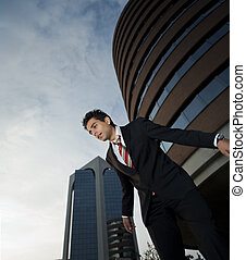 winner - successful businessman staring at the ground a bit...