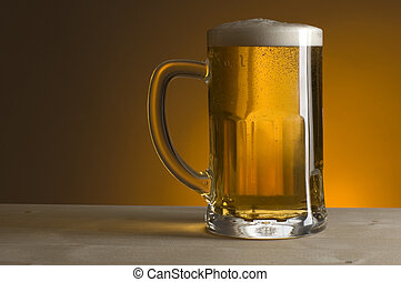 beer - glass of beer on orange background close up