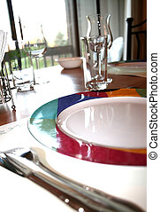 Dining table with empty glasses and plates