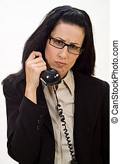 Disturbing Call - Woman holding an old school phone looking...