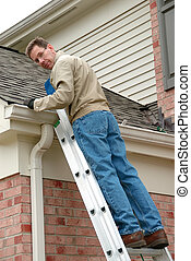 Roof Repair - Man on a ladder, cleaning the gutters and...