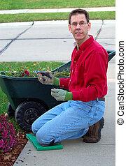 Gardener - Yard Work - Man doing spring or fall yard work.