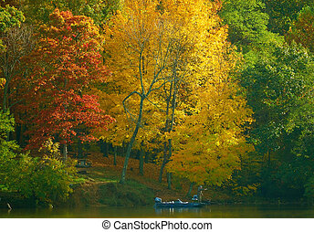 Fishing in Color 2 - A fisherman trolling along the banks of...